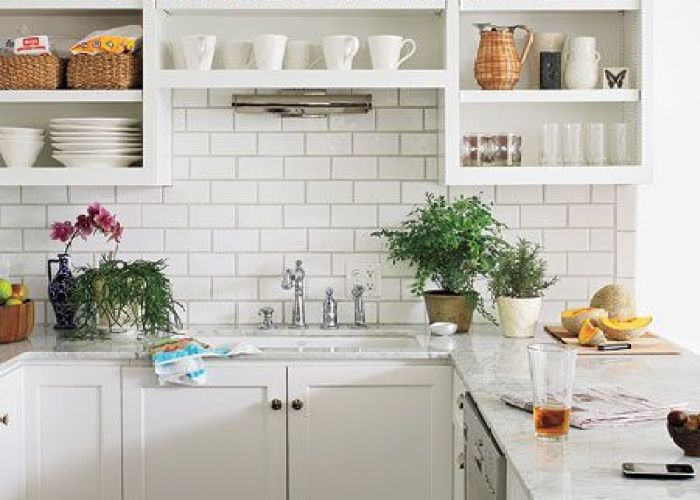 White kitchen design with lots of open storage glossy subway tiles backsplash creamy cabinets polished nickel faucets also pin by joanna grunwald on for the home pinterest tile
