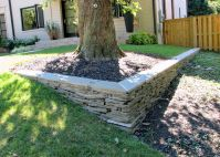 stone walls landscaping | Dry stacked stone wall with a ...