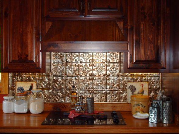 punched tin backsplash behind stove kitchen