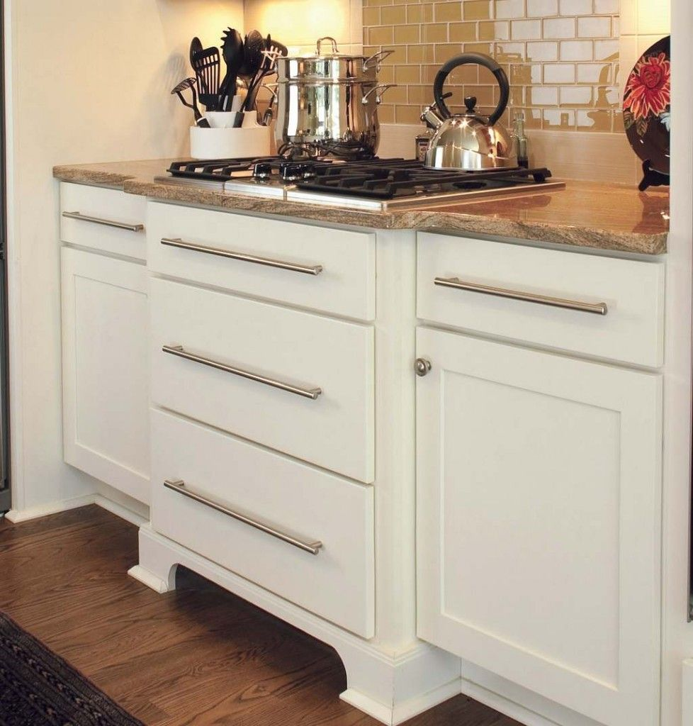 White Shaker Cabinets With Slab Drawer Fronts Used To