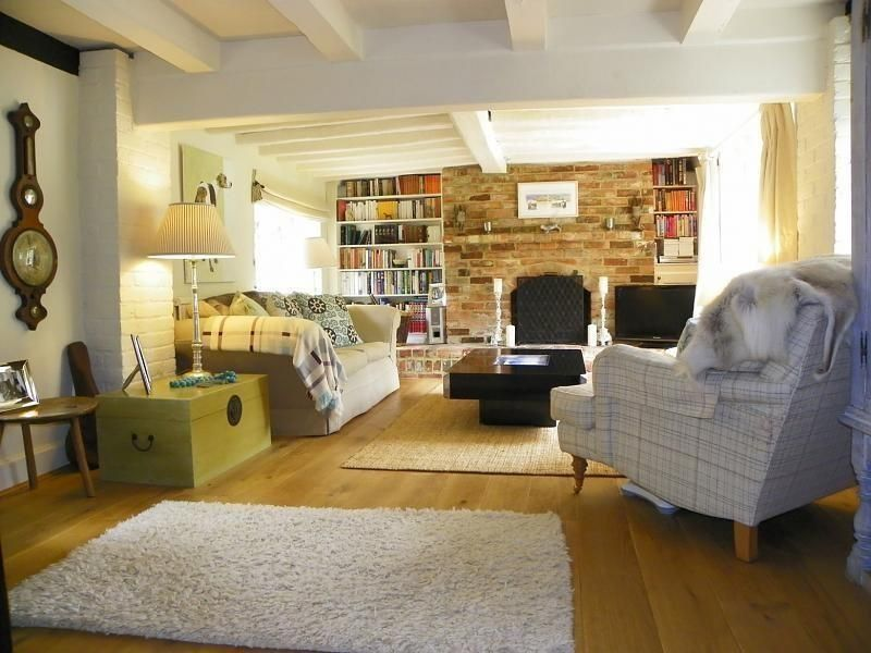 photo of comfy cosy rustic beige white exposed brick