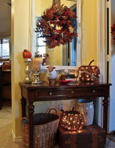 Home decoration ideas entry way decorations for fall that glow and sparkle  like the idea of lighted pumpkins  wreath hung over mirror also best images about decorating seasons holidays on rh pinterest