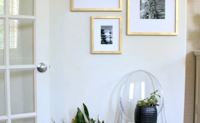 Gallery Wall With Target Frames Painted Gold With Black