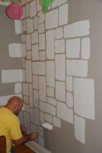a castel stone wall., Painting the stones onto the wall ...