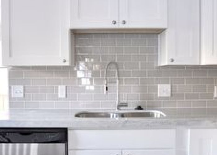 white subway tile backsplash with gray grout cabinets also don   mind doing baby laundry in this pretty room