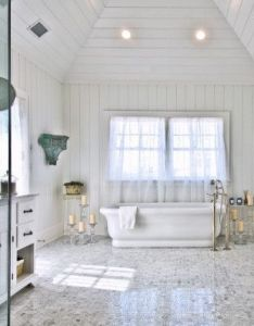 Image of adorable beach cottage style bathrooms with white porcelain bathtub nearby moen floor mount tub filler and glass pillar candle holders abo  also rh pinterest