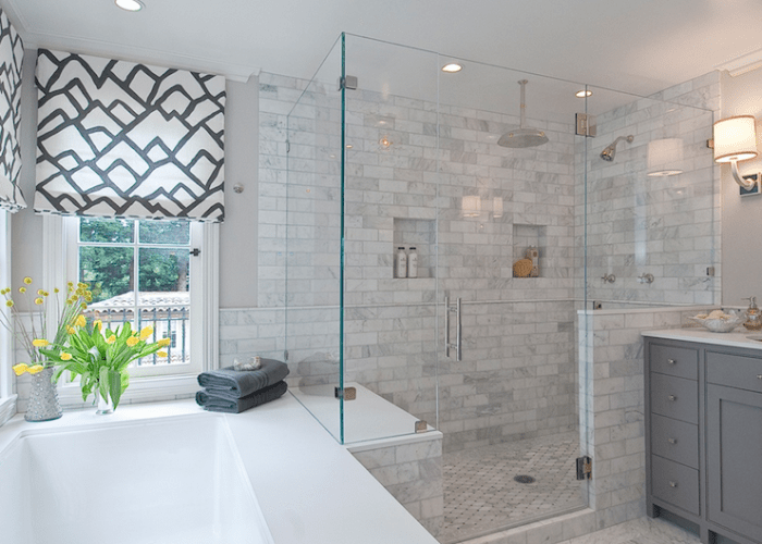 Shower tile master bathroom with custom roman shades in  schumacher zimba charcoal fabric cool gray paint color drop tub seamless glass also