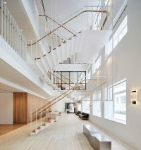 Piercy & Company suspends steel staircase in new atrium of ...