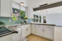 Mid-Century Modern Kitchen with white cabinets, quartz ...