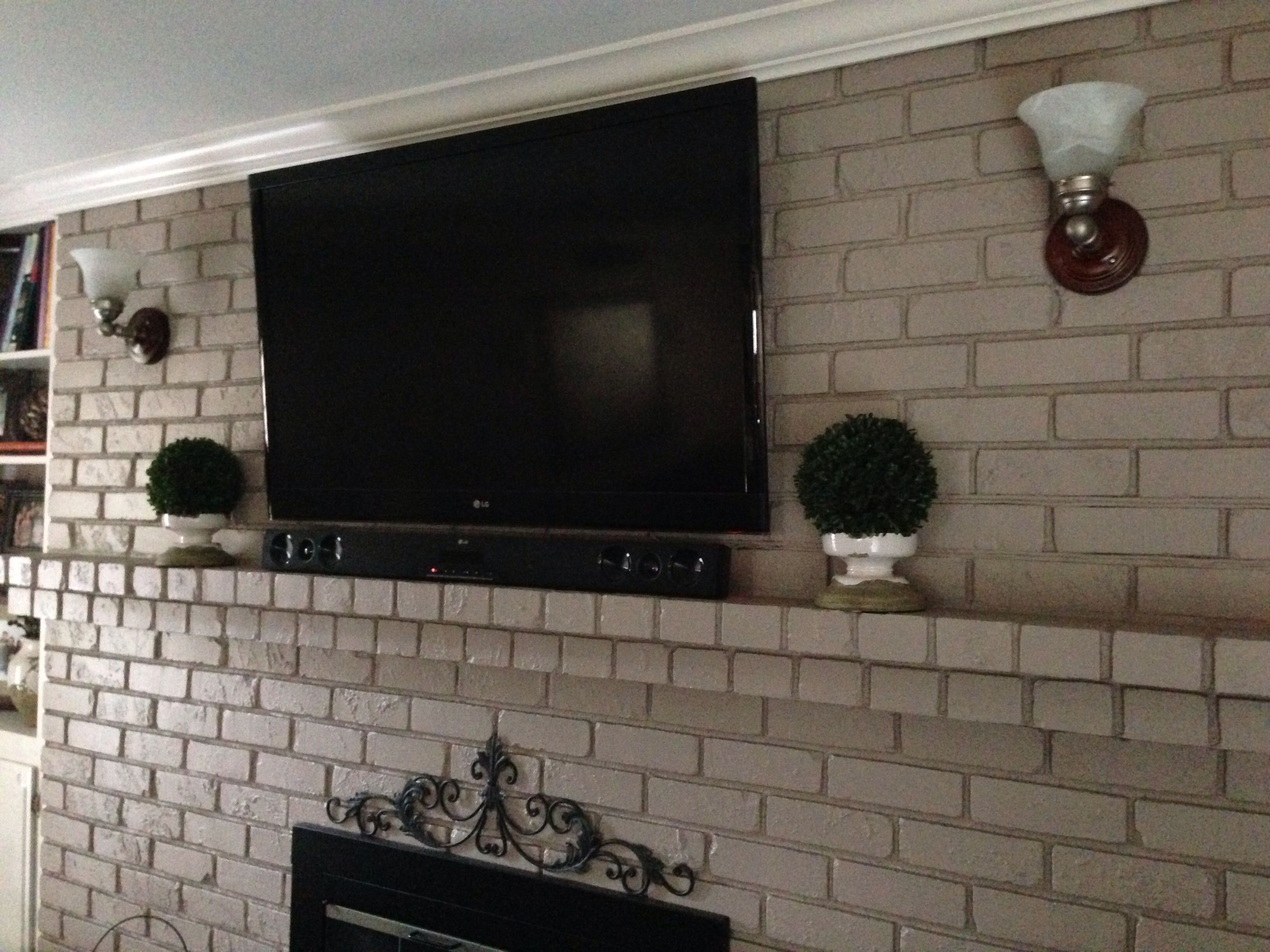 Yes you can mount your tv to your brick fireplace without the wires showing The wires are