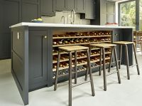 Grey/black kitchen island design with integrated wine rack ...