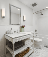 White marble tile floor. White subway tile half wall with ...