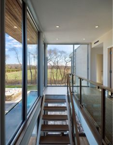 Blaze makoid architecture designed the fieldview house in east hampton new york located on  flat one acre flag lot with neighbors close to front and also staircase view up  down pinterest staircases rh