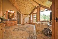 Log influences on interior of master bath. Round log post ...