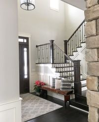 Neutral modern farmhouse foyer with wainscoting, stained ...