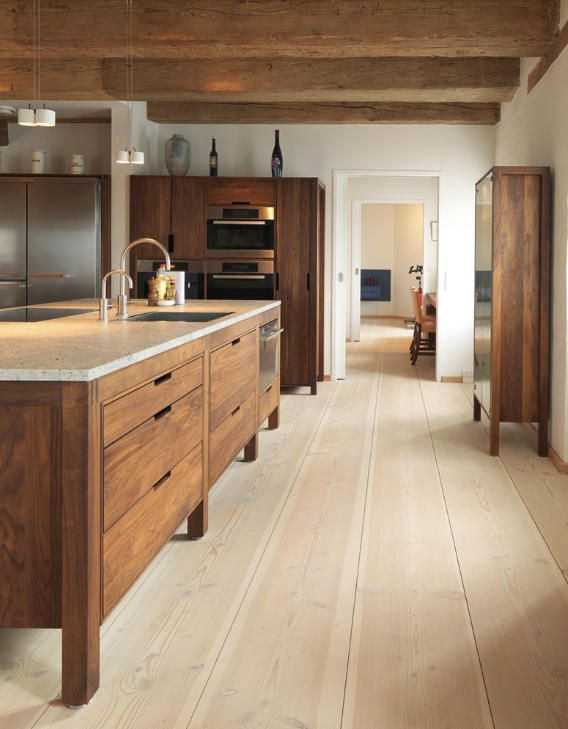 Modern rustic kitchen with modern wood cabinets. Wood