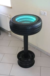 Recycling! A bar table made from an old tire and rims ...