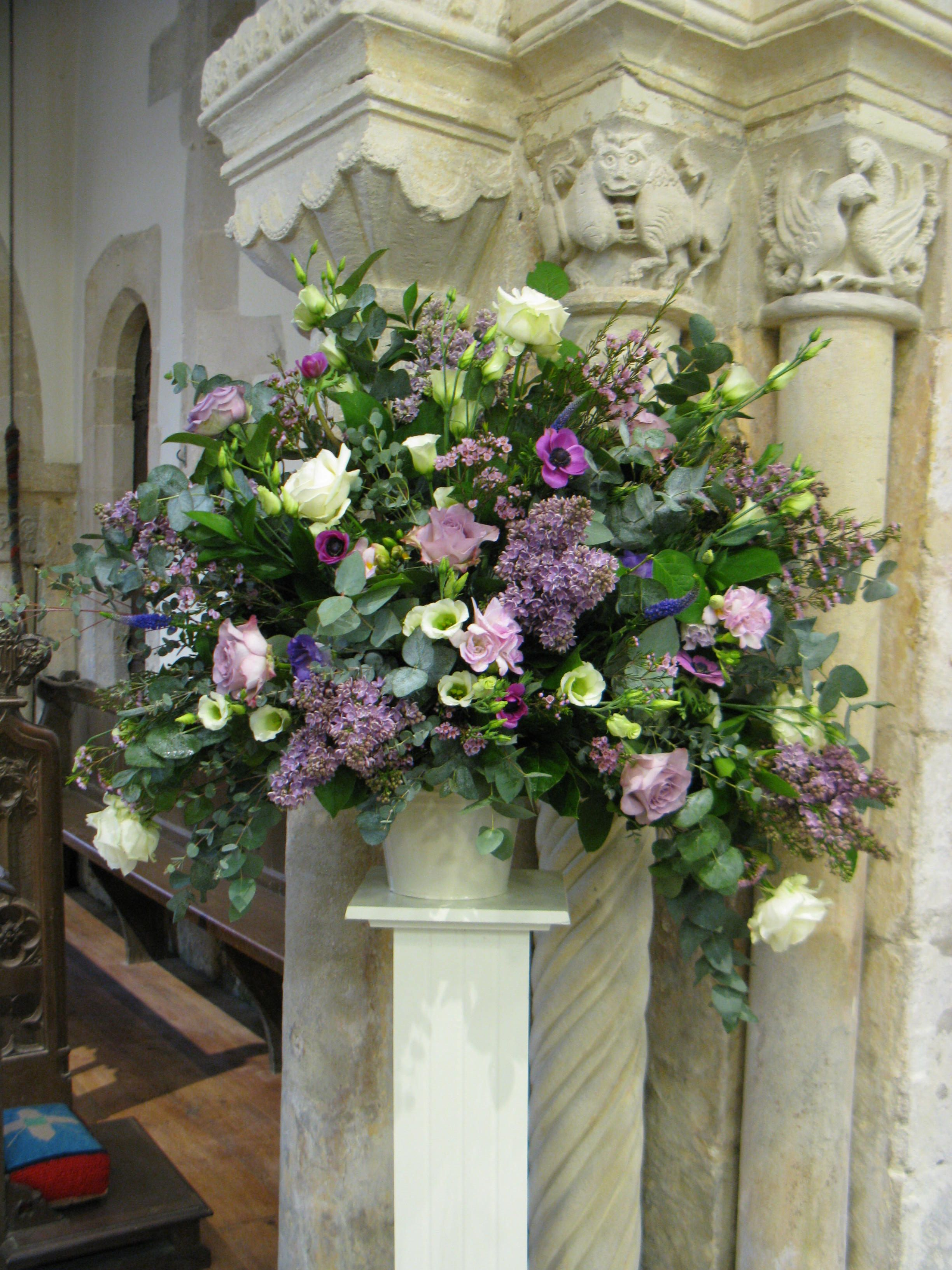 A Pedestal From A Spring Wedding In Jewel Coloured