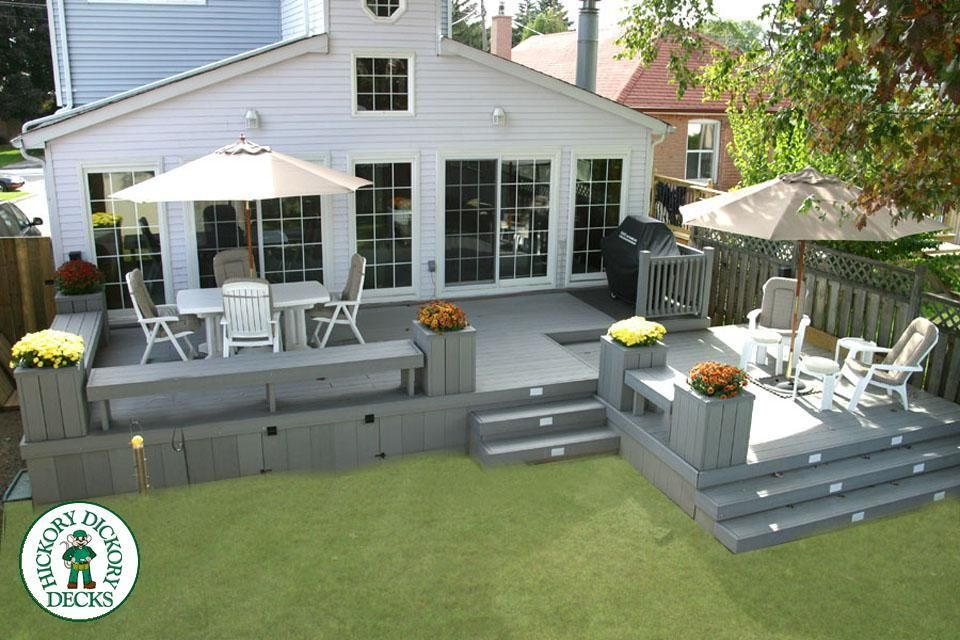 This Lovely Bi-level Deck Spans The Entire Back Of The