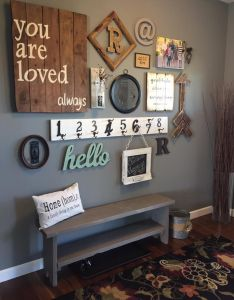 This entry way gallery wall is gorgeous    loving new space in my home rustic decor pinterest spaces and walls also rh