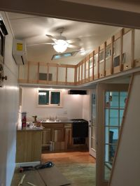 white interior tiny house/tiny home with lofts and catwalk ...