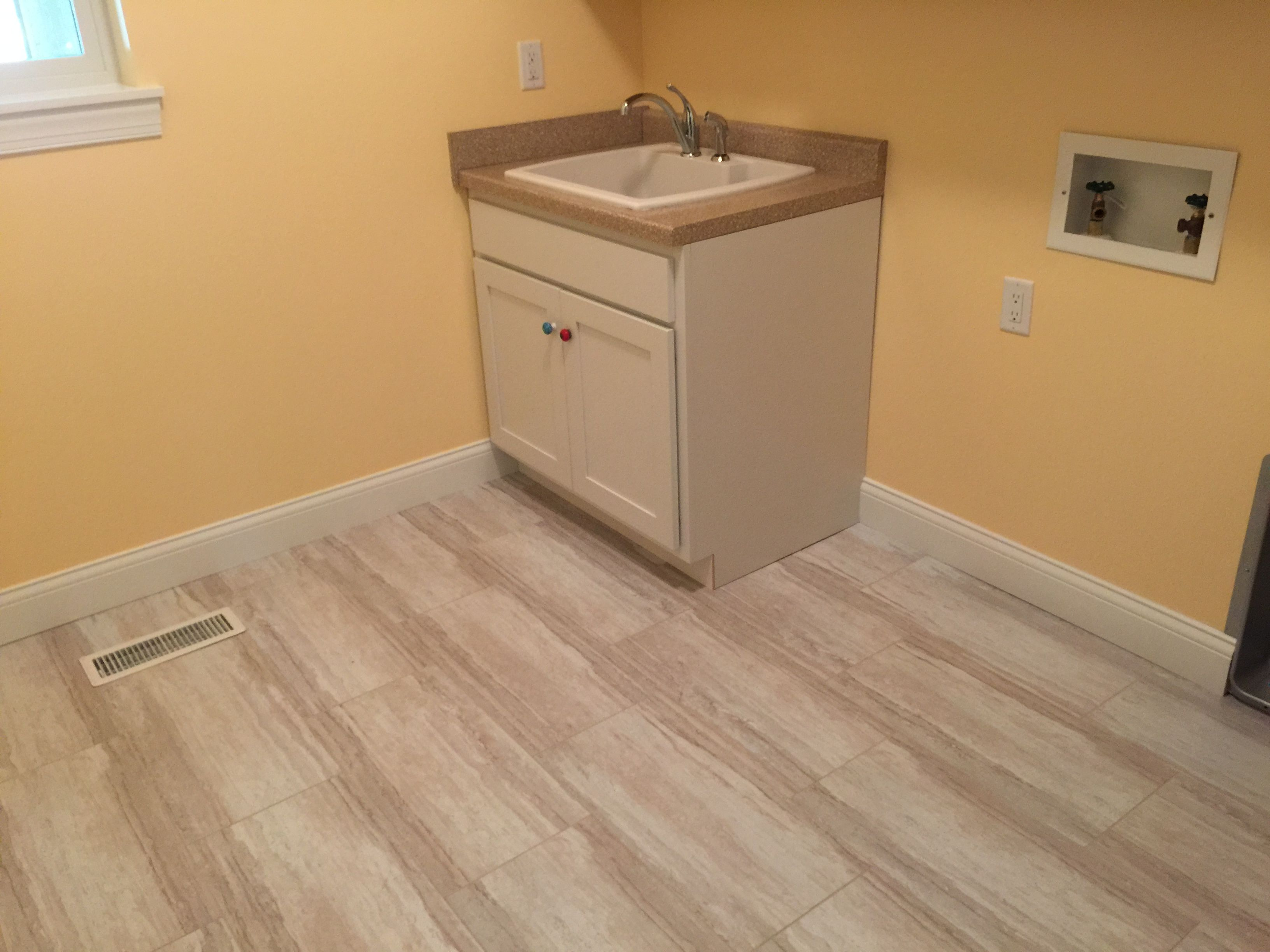 Luxury Vinyl tile grouted and installed in a staggered