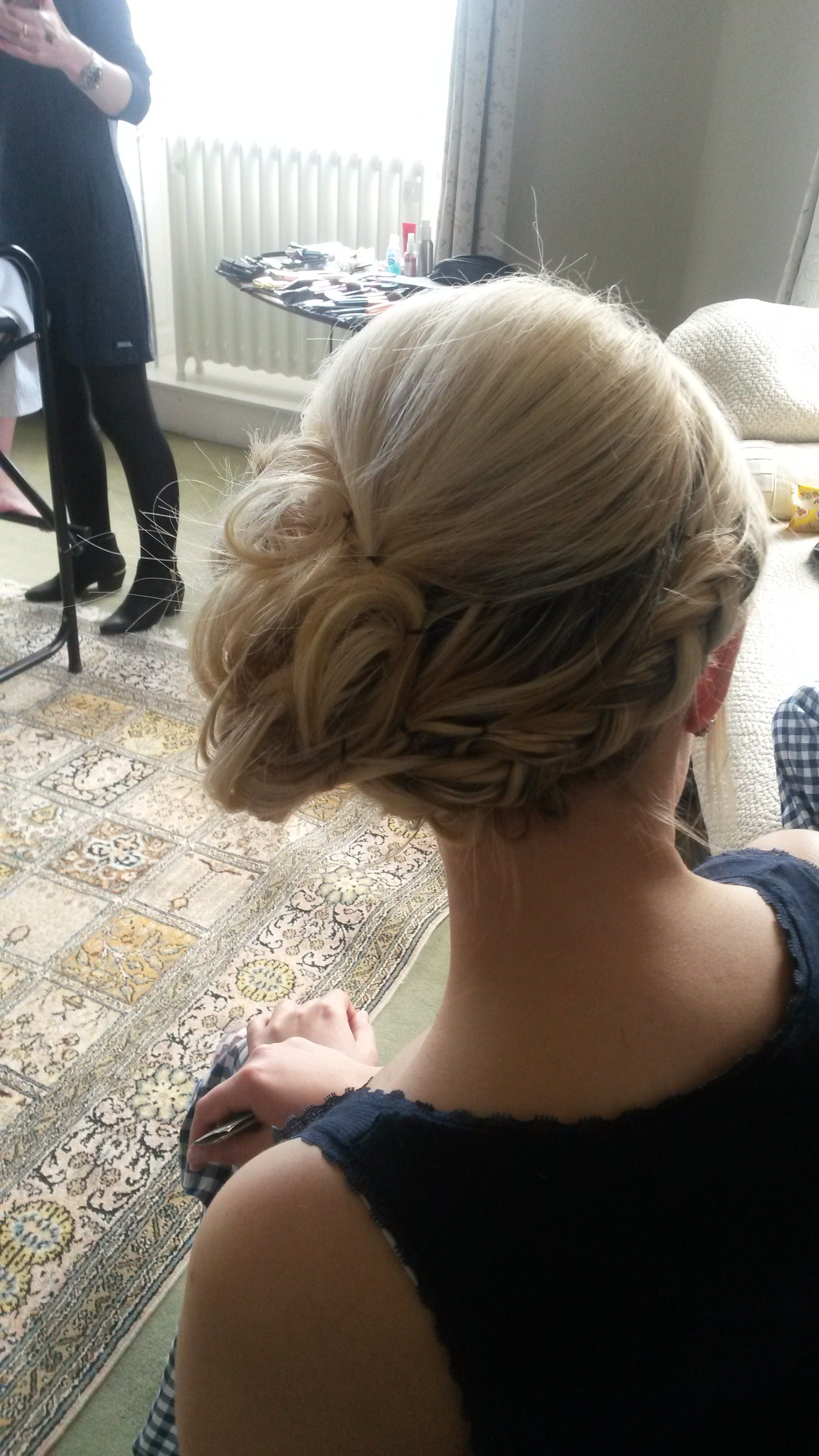 Dutch plait with messy side bun