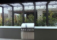Decorative screens can enclose a patio space in unique and