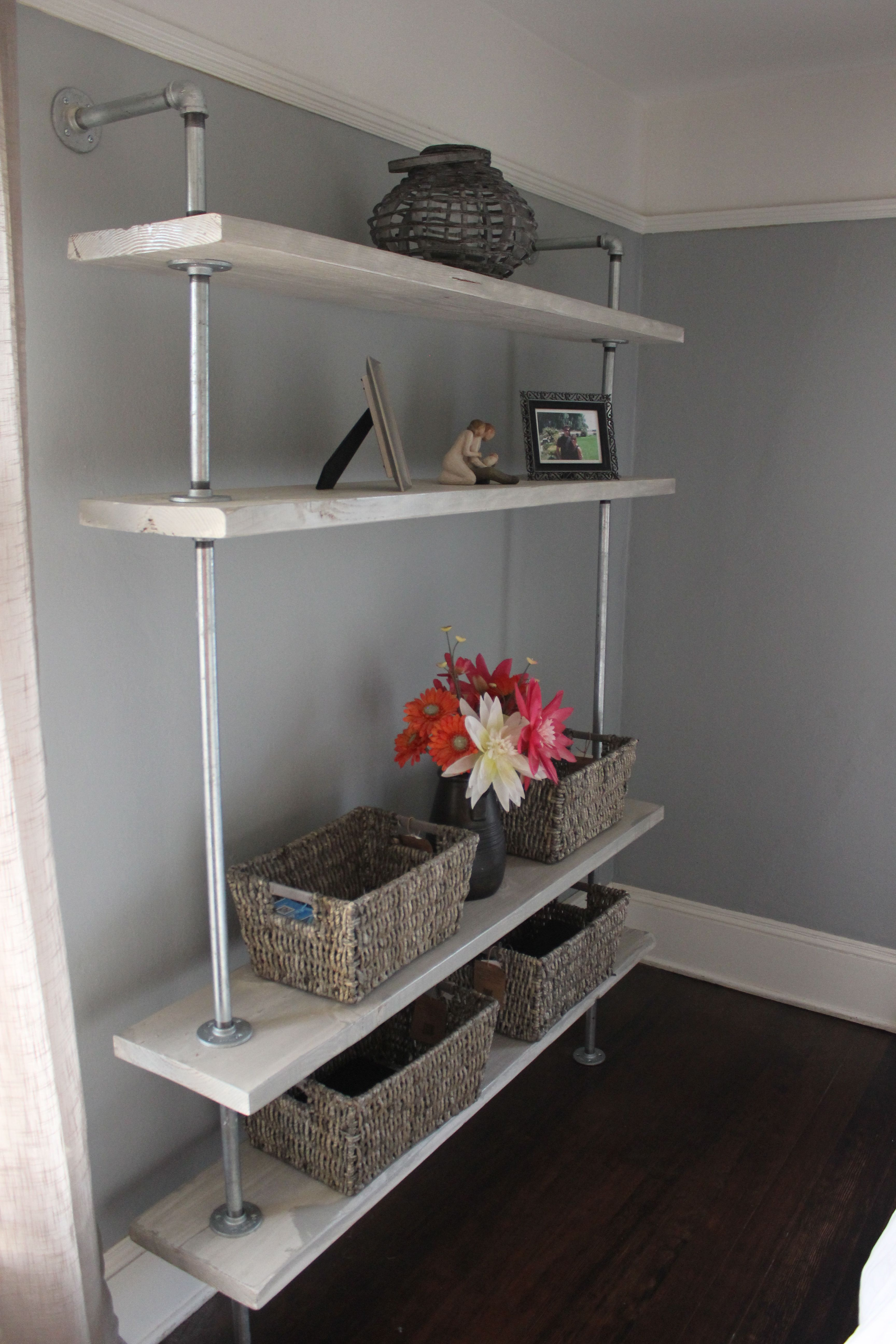 Grey Rustic Diy Shelf Made From Metal Plumbing Pipes And