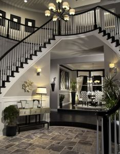 Double arched stairs descending down the round foyer creating  two story entrance way floor is grey tile leads up also future room diys pinterest house and rh