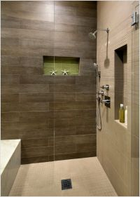 shower with dark brown tile and light floor