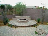 Backyard patio with paver stones, fire pit and seating ...