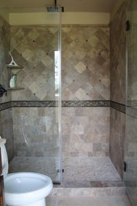 Contemporary shower design with travertine #tile, mosaic