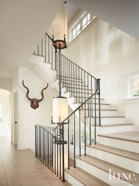 Contemporary White Stairway with Custom Light Fixture ...