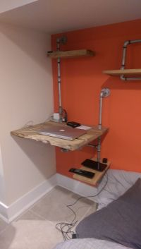 Hanging wall desk with plumbing pipe