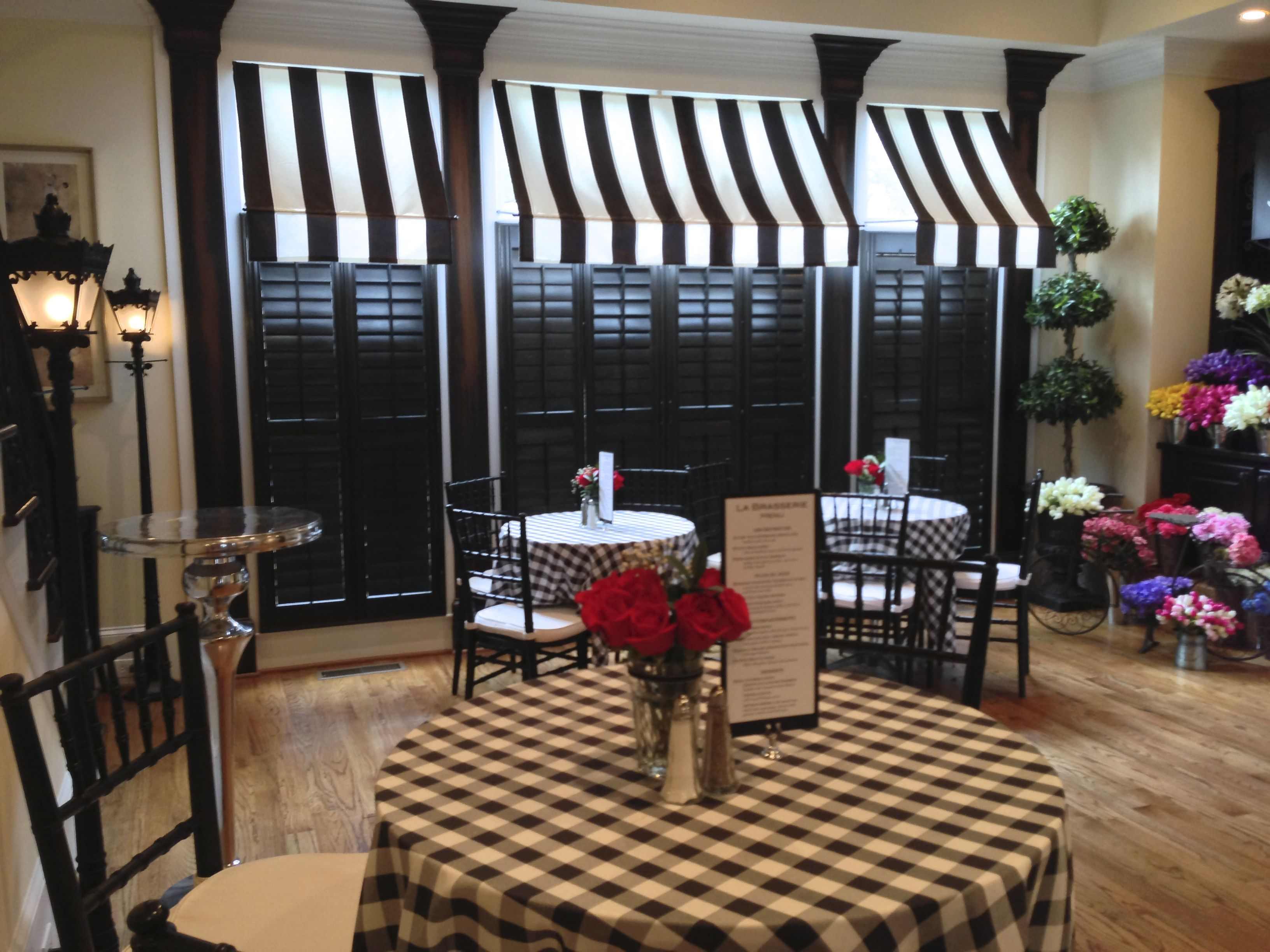 cafe themed kitchen decor stonewall products black and white awnings created the feel of a parisian