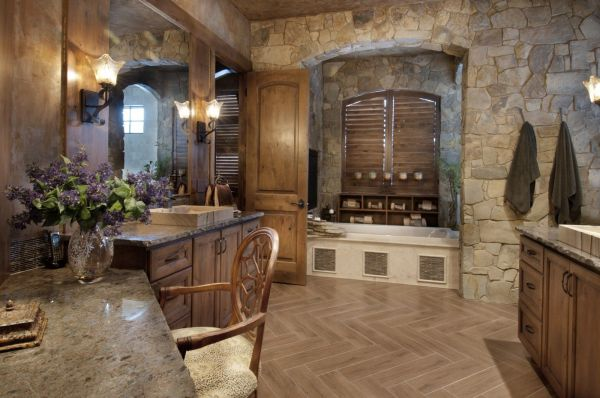 Rustic Mountain Master Bathroom With Rock Wall And