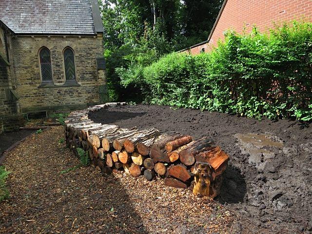 raised bed using logs
