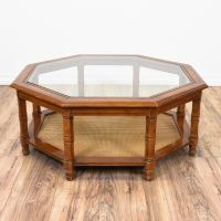 This octagon coffee table is featured in a solid wood with ...
