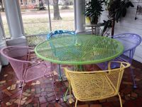 Spray painted wrought iron patio furniture using Rustoleum