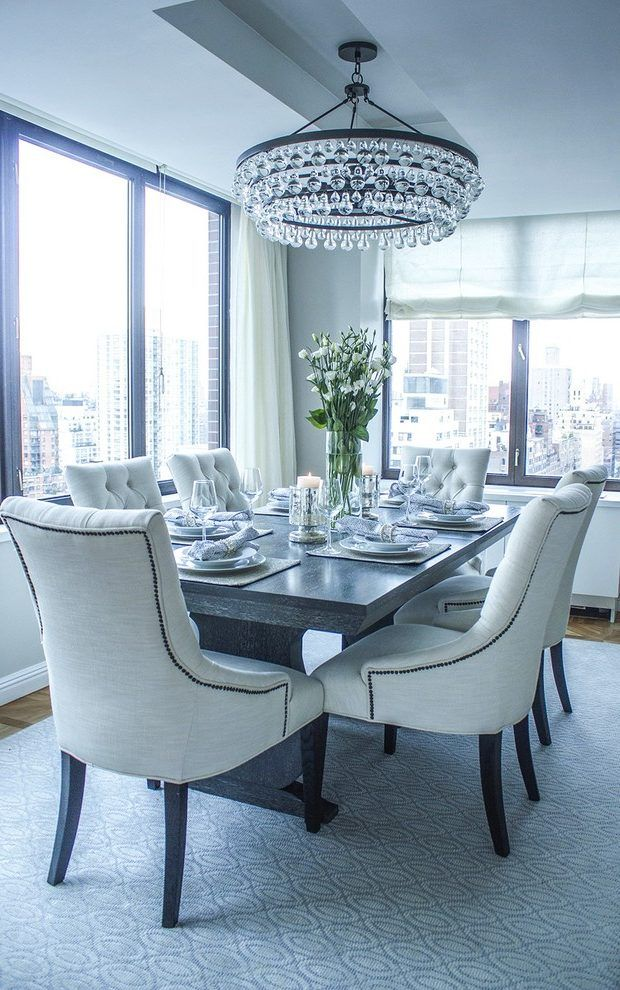 Transitional Dining Chair Room With City View Gray Table Crystal Chandelier