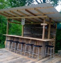 "Our little ""tiki bar"" from pallet wood and salvaged metal ..."