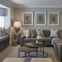 The neutral colors of this living room are perfectly ...