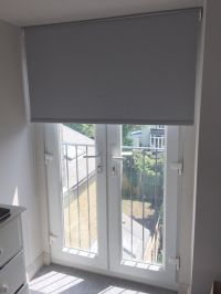 Blackout roller blind in flint colour to French doors for ...