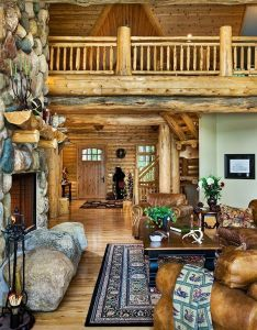 Log cabin home interior love the fireplace also cozy on  grande scale lodge style retreat in michigan room rh pinterest