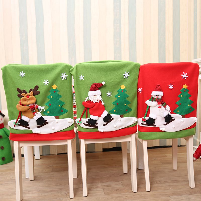 christmas chair covers pinterest teardrop swing sliding santa claus cover set skiing style event xmas party hat for
