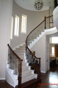 Very light and bright entry with a curved staircase, wood ...