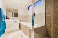 A nice modern neutral bathroom idea. You can use towels to ...