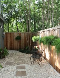 """Update: Rocks added to back """"yard"""" space to replace mulch ..."""