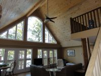 Custom Home with vaulted ceilings finished in cedar tongue ...